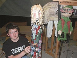 Zach with puppets