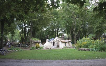 Community-built cob structure in park